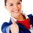 Flight attendant with thumbs up — Stockfoto
