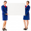 Flight attendants with a banner — Stock Photo #9356363