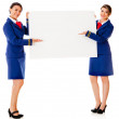 Stock Photo: Air hostesses with banner