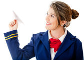 Stewardess with a paper airplane — Stock Photo