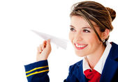 Air hostess with a paper airplane — Stock Photo