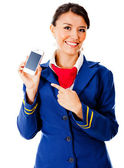 Air hostess with a smart phone — Stock Photo