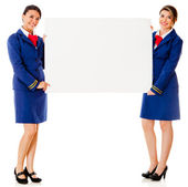 Flight attendants with a banner — Stock Photo