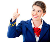 Air hostess pointing with finger — Стоковое фото