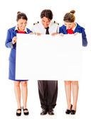 Airplane cabin crew with banner — Stock Photo