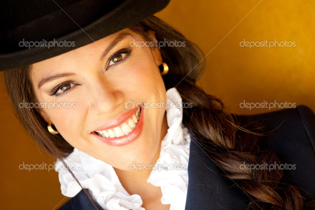 Beautiful horsewoman portrait wearing a hat and smiling — Stock Photo #9356259
