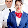 Stock Photo: Pilot and air hostess