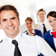 Captain with cabin crew — Stock Photo