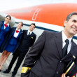 Stock Photo: Captain pilot with cabin crew