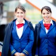 Stock Photo: Beautiful flight attendants