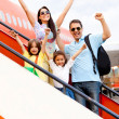 Happy family going on holidays - Stock Photo