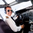 Stock Photo: Pilot in airplane cabin