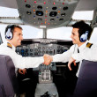 Pilots handshaking - Stock Photo
