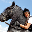 Woman with a horse - Stock Photo