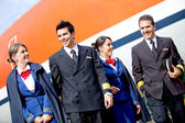 Pilots and flight attendants — Stock Photo