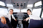 Pilots in an airplane cabin — Stok fotoğraf