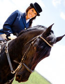 Woman horseback riding — Stock Photo