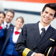 Captain pilot with cabin crew — Stok fotoğraf