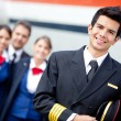 Captain pilot with cabin crew - Stock Photo