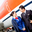 Stock Photo: Pilot and flight attendant
