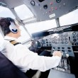 Pilot flying an airplane - Stock Photo