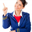 Stock Photo: Air hostess pointing with finger