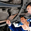 Stock Photo: Mechanics fixing car