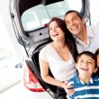Family buying a car - ストック写真