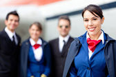 Flight attendant with cabin crew — Stock Photo