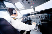 Pilot flying an airplane — Stock Photo