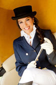Elegant female jockey smiling — Stock Photo