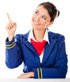 Air hostess pointing with finger — Stock Photo