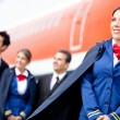 Flight attendant with cabin crew — 图库照片