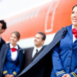 Flight attendant with cabin crew — Stock Photo