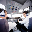 Pilots flying airplane — Stock Photo