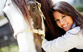 Woman stroking a horse — Stockfoto