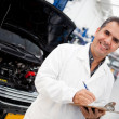 Mechanic at a car garage — Stock Photo