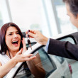 Woman buying a car - Photo