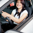 Woman driving her new car — Stock Photo