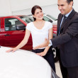 Woman buying a car — Stock Photo #9415658