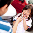 Excited girl buying a car — Stock Photo