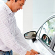 Stock Photo: Man opening a car