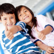 Kids with thumbs up — Stock Photo #9415668