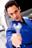 Mechanic with a wrench — Stock Photo