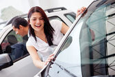 Couple looking at cars — Stock Photo