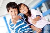 Kids with thumbs up — Stock Photo