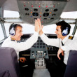Pilots in an airplane cabin - Stock Photo