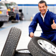 Mechanic working on wheels — Stock Photo #9469311