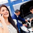 Stock Photo: Womcalling mechanic