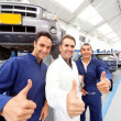 Stock Photo: Mechanics with thumbs up